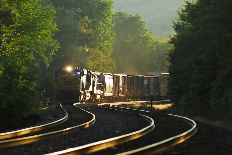 CSX Q436 drifts downhill past Middlefield Station in last light of September 4, 2009.