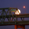 The moon setting behind the Tobin Bridge.