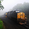 An eastbound CSX Intermodal train breaks through the fog in Middlefield, May 30, 2009.