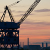 Boston harbor crane at sunset