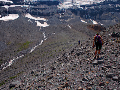 Heading out into the moraine, and the source of the river at the base of the glacier (in the distance).