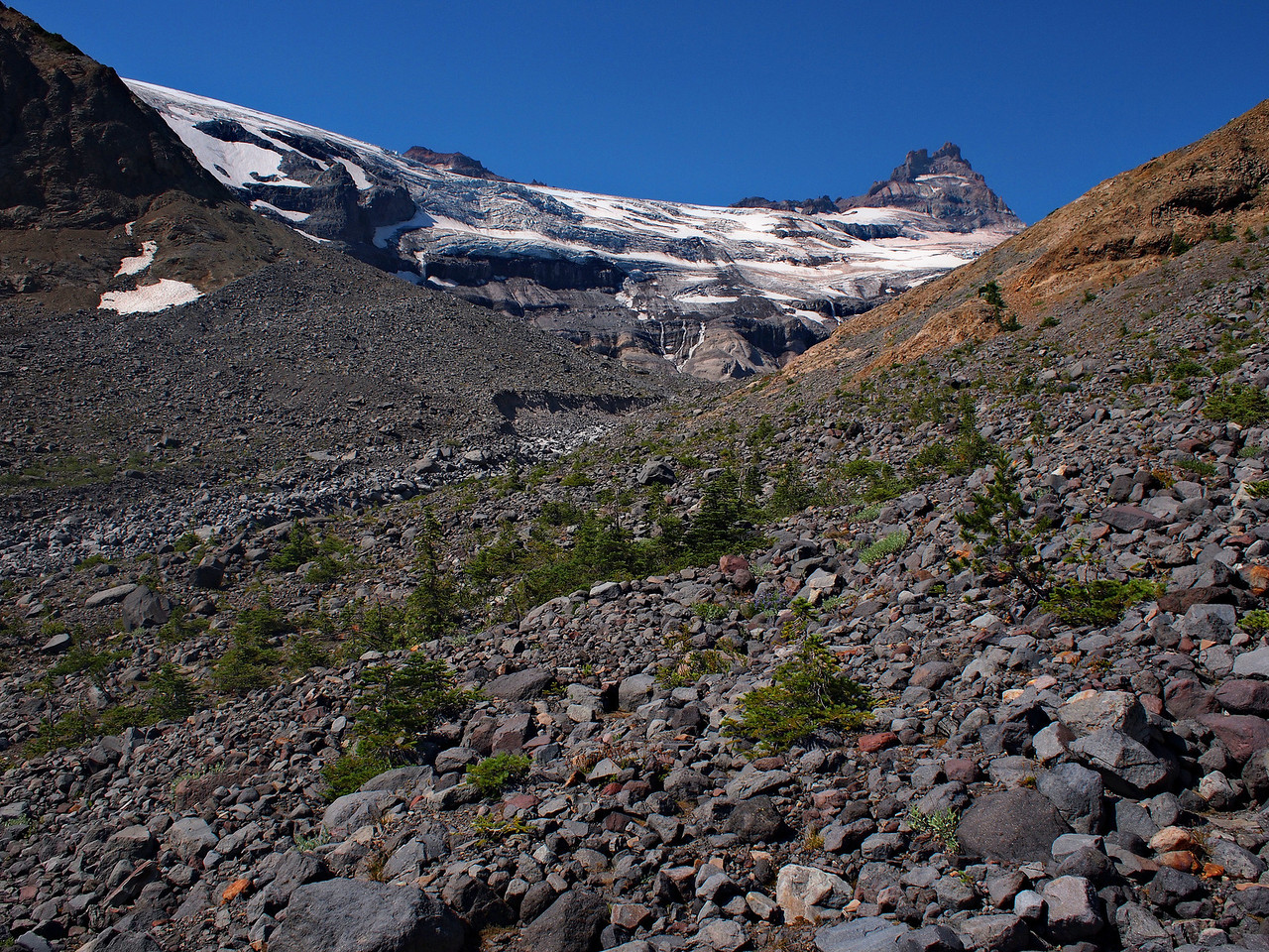 Looking up at the extended moraine field, and the edge of the glaciers responsible for that and the water.