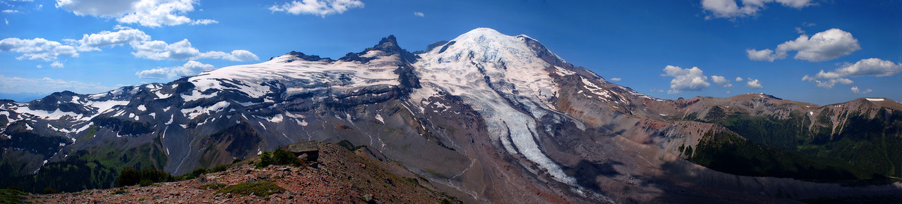 "A panorama composed of several photos from the spine of Goat Island Mountain. Summerland is visible in the lower left. Emmons Glacier is seen extending from the mountain to the lower edge of the photo. Burroughs Mountains to the far right. Best to use ""X3 Large"" size to view."