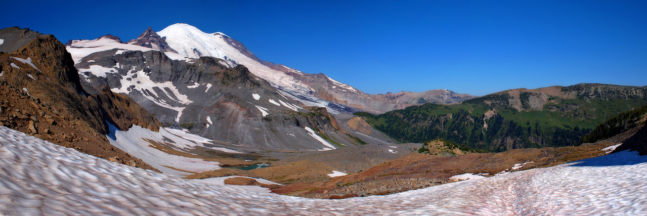 "Panorama near Panhandle Gap, looking back at Mt. Rainier, with Goat Island Mountain in the distance to the right. Best to use ""X3 Large"" size to view."