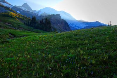 Sun setting behind the mountain.