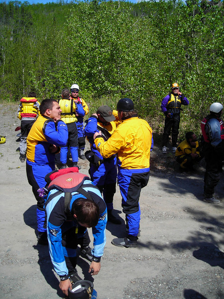 Rescuers suit up to get wet while staying dry.