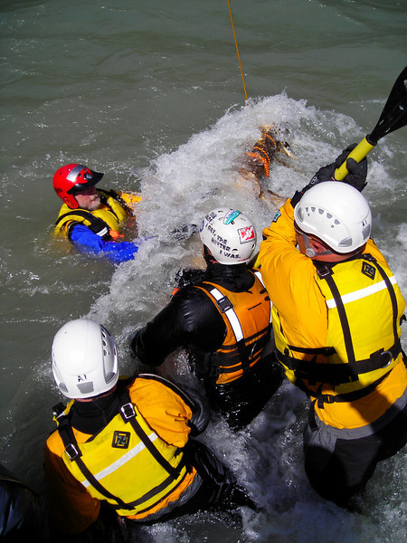 A feet-first catch on a strainer is a bad position to get into, which is why we train by doing it.  Rescuers know how hard it is to recover from without being sucked under by the current.