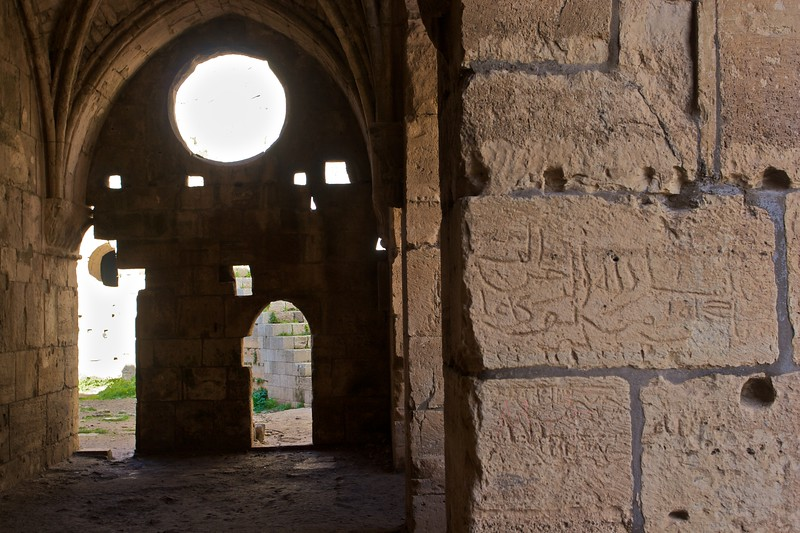 Arabic graffiti (scratched on by Saladin's forces?) in the cloister of the Crac des Chevaliers.