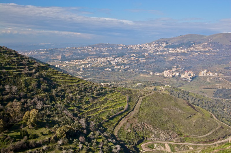 View over the undulating green countryside of west-central Syria, as seen from the outer walls of the Crac des Chevaliers.