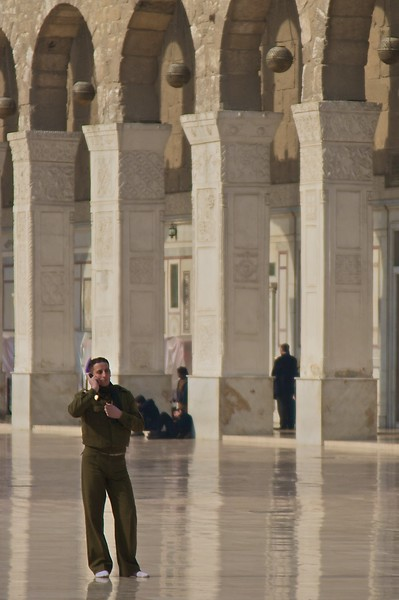 On the phone in the central courtyard of the Umayyad Mosque.