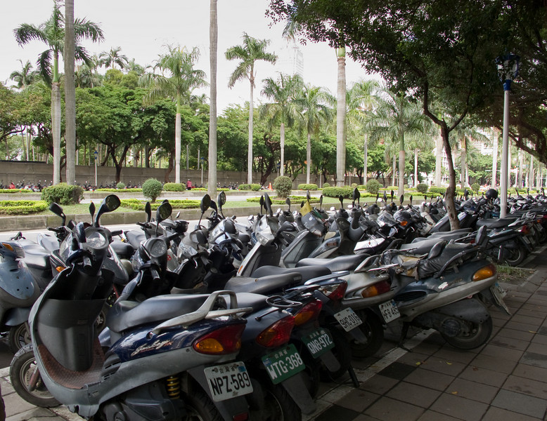 A double row of scooters in the government district