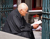 Longshan Temple, old man reading and chanting