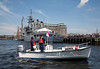"""Coast Guard Auxiliary near the Navy Yard.  In the background, the Irish Helicopter Patrol Ship """"LÉ Eithne""""."""