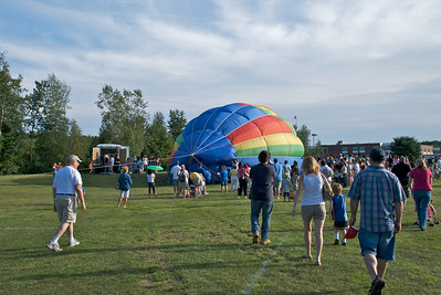 The first balloon is half way inflated.