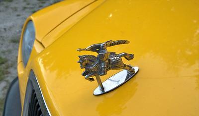 The cab's hood ornament... cute.