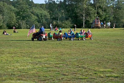 Keeping the kids occupied with a ride around the field until it was time for the balloons to go up.