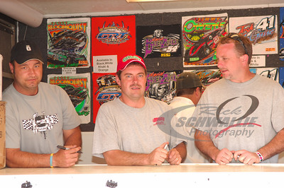 Dan Schlieper, Ray Cook and Jimmy Owens waiting to sign autographs