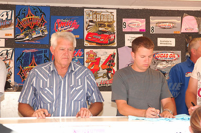 Freddy Smith and Steve Casebolt signing autographs