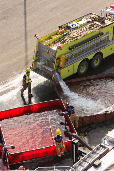 A tanker drops off some water at one of the fold-a-tanks supplying the platform.