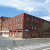 "This entire block is vacant and sits at the intersection of Dwight St. and Canal St. in Holyoke, Mass. Note the 4 story vacant attached building on the C side as well as the ""Structurally compromised/Do Not Enter plaquared on the A side."