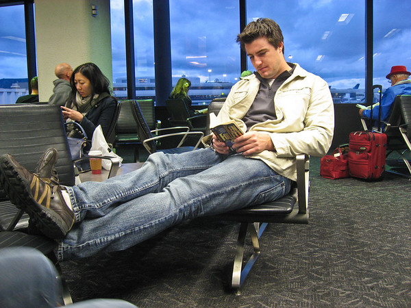 Dan reading his book while we wait for the flights to board