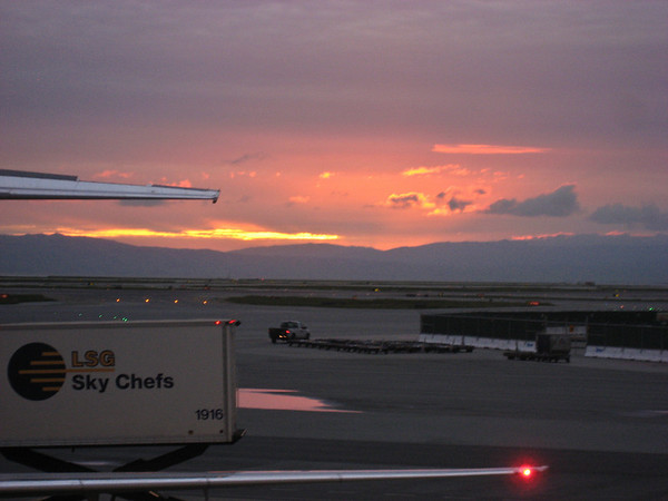 The pretty sunrise view out of SFO Airport before our flight