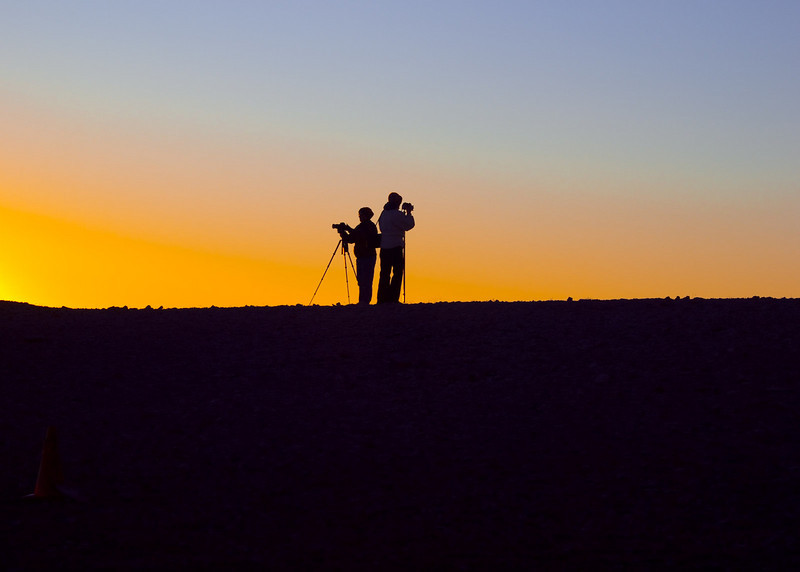 Photographers await sunrise