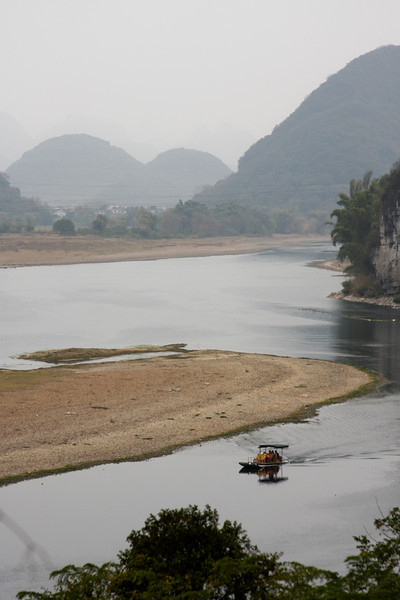 Winter has lowered the water level of the Li River, but not to a point prohibiting boat travel.