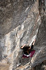 The first pitch of <i>Paparazzi Pete 5.9</i> passes under Tracy's fingers and toes as she climbs toward the anchor.