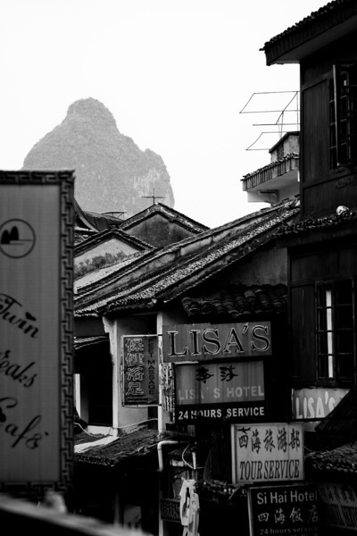 Yangshuo is a small tourist town contained in a beautiful part of southern China between massive looming Karst towers and beside the peaceful Li River.