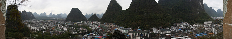 A small karst tower in downtown Yangshuo is topped by a pagoda, thoroughly trashed and polluted by the many visitors who make their way to the top.  The views offered from the small balcony are quite worth the walk though, if one can ignore the trash and graffiti.