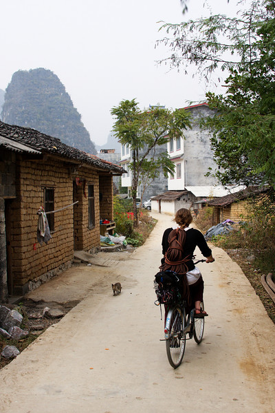 Tracy wanders down a village street in search of some climbing.