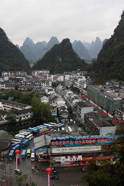 Yangshuo's bus station stays busy all day, bringing tourists from everywhere in the world to spend their money on the town's souvenir industry.