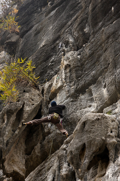 Tufas are features seldom found in mainland North America, and are not something to be neglected while climbing the steep limestone of Southeast Asia.  Chris stems away from the wall to take some weight off his hands.