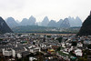 The small tourist town of Yangshuo is nestled cozily between the massive towers of the surrounding karst topography.