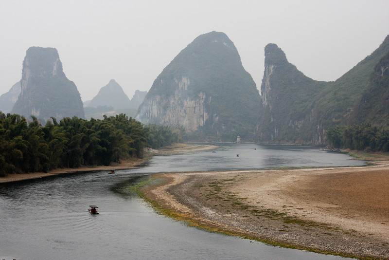 Boats travel up and down the Li River amid south China's beautiful Karst topography.
