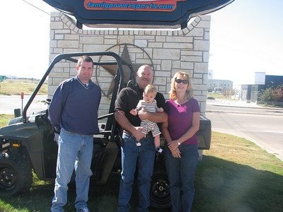 Marty Pennell of Family PowerSports with winners Jerry & Tiffaney Grant and grandson