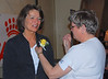 Board member Kathy Cummings pinning a corsage on Bob's wife Esther, who came to the show to compete with Bob's boy River.