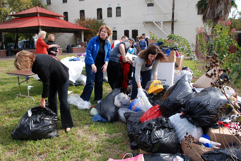 At the Clara White Mission, volunteers help sort sweaters.