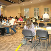 Housing counselors work with homeowners at Rep. Carroll's foreclosure workshop.