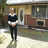 Linda Woolbright in front of her Northside home.