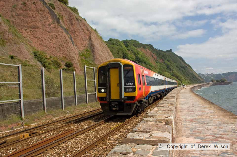 090627-020     SouthWest Trains class 159 unit no. 159106 speeds along the seafront at Teignmouth, with the 07.10 London Waterloo - Paignton.