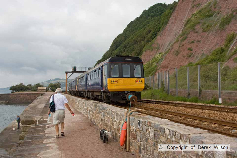 090627-004    FGW pacer units, class 142 no 142068 & 142029 are seen 'heading away',  passing along Teignmouth sea wall, with the 08.23 Exeter St Davids - Paignton.