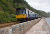 090627-003     FGW pacer units, class 142 no 142029 & 142068 are seen passing Teignmouth sea wall, with the 08.23 Exeter St Davids - Paignton.