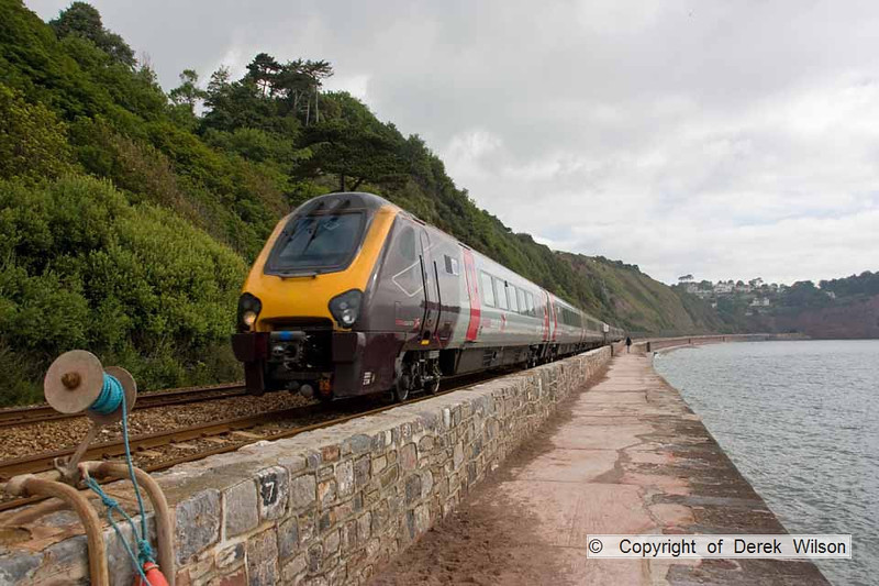 090627-001     Cross Country Trains class 221 no 221114 & class 220 no 220014 form the 06.42 Birmingham New Street - Paignton. They are captured passing along the scenic sea wall at Teignmouth.