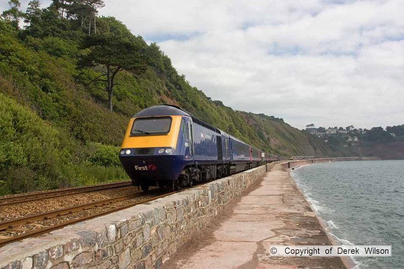 090627-016     A FGW HST set, powered by 43180 & 43190 is seen speeding past the sea wall at Teignmouth, with the 07.30 London Paddington - Penzance.