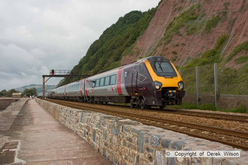 090627-005     Cross Country Trains class 220 no 220011 & class 221 no 221141, speeding past Teignmouth with the 08.40 Plymouth - Manchester Piccadilly.
