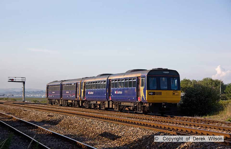 090627-023     FGW pacer units, 142001 & 143603 are seen arriving at Dawlish Warren with the 17.55 Exmouth - Paignton.