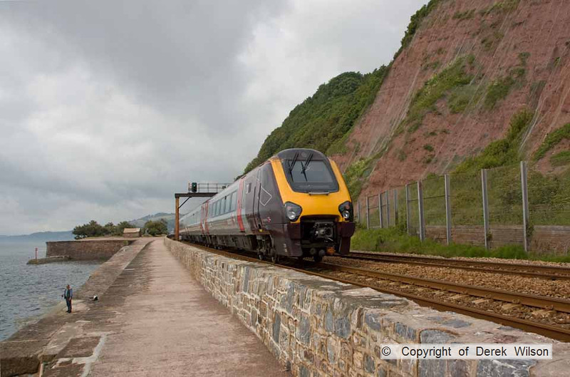 090627-002     Heading away from the camera are Cross Country Trains class 220 no 220014 & class 221 no 221114, forming the 06.42 Birmingham New Street - Paignton. They are captured passing along the scenic sea wall at Teignmouth.