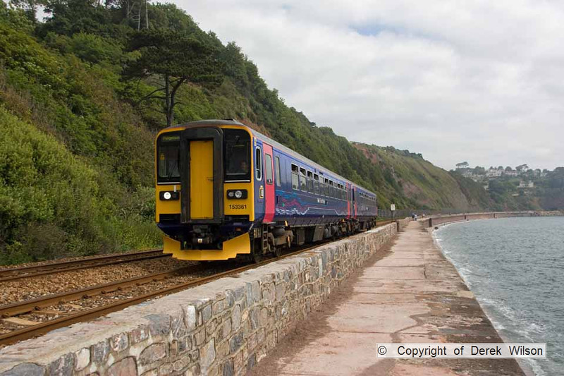 090627-015     A pair of FGW class 153 units, led by 153361 pass along the sea wall at Teignmouth, with the 09.23 Exeter St Davids - Paignton.